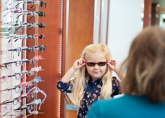 Midwestern University Eye Institute Child Trying On Affordable Eye Glasses