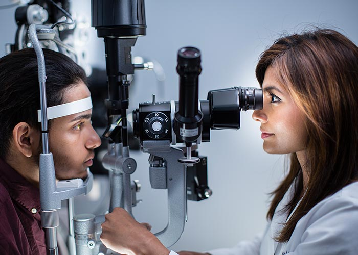 Midwestern University Clinics Eye Institute Optometrist Performing Vision Screening